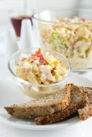 Chicken ham, corn, red bell pepper, pineapple and apple salad photo