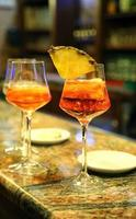 alcohol aperitif with a glass chalice at the bar