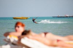 Kiteboarder enjoy surfing