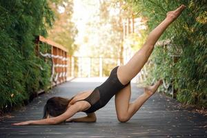 Young woman is practicing yoga photo