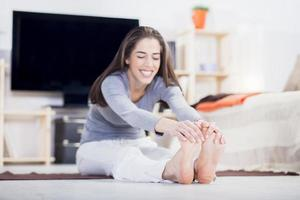 Woman is doing fitness at home in living room