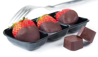 Row of strawberries dipped in delicious chocolate photo