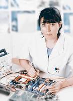 Tech tests electronic equipment photo