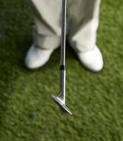 jugador de golf con club foto