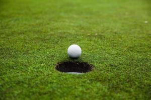 Golf ball on green meadow.