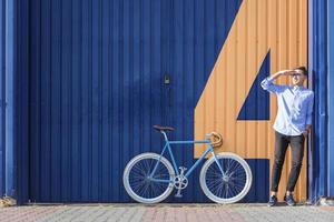 Businessman standing beside his bicycle photo