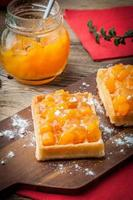 Waffles with peach jam. photo