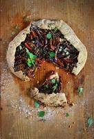 Plum and apricot nut and marjoram tart or galette, pie dessert