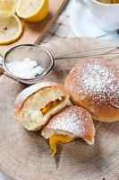 Freshly baked sweet buns with jam photo
