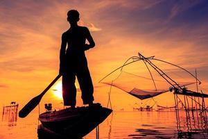 silhouette of fishermen photo