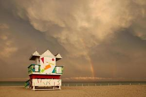 Storm clouds with rainbow over Miami Beach Florida