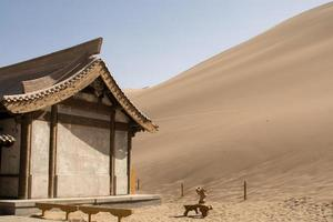 Chinese pavilion near sand dunes in desert, Dunhuang, China