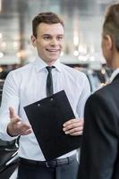 Salesman and customer. photo