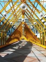 Yellow bridge of trusses and beams
