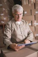 Warehouse worker using digital tablet photo