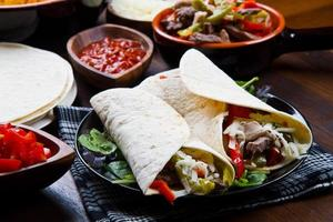 homemade Chicken  Beef Fajitas with Vegetables and Tortillas photo