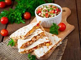 Mexican Quesadilla wrap with chicken, corn and salsa
