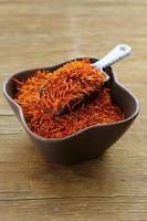 Saffron spice on a wooden background macro shot soft focus photo