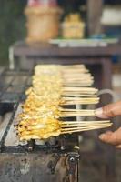 Satay grilled on stove.
