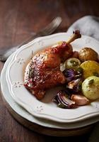 Oven-roasted duck legs and vegetables (autumn style) photo