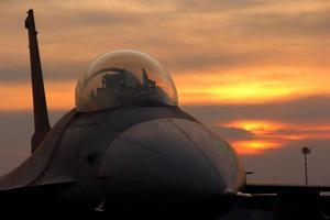 F16 on sunset background photo