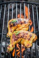 Roasted chicken legs on the old grill