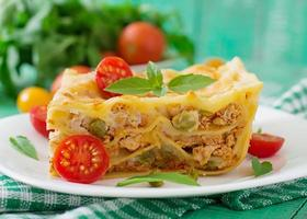 Lasagna with minced meat, green peas and sauce