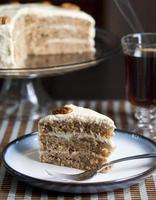 Hummingbird cake on a plate with a fork