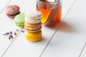 Macarons on white wooden background photo