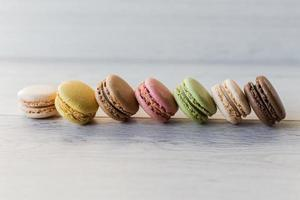 Colorful tasty macarons in a row