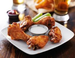 hot bbq buffalo chicken wings with celery and ranch