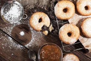 Homemade donuts on a wooden table photo