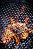 Grilled chicken leg with rosemary