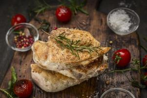 Grilled chicken breasts roast herbs rustic wooden background