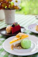 Cheese cake and ice-cream on plate with fruit topping. photo