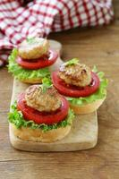 appetizer mini burgers with tomatoes, lettuce and meat balls