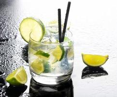 Fresh made mojito on watery background photo
