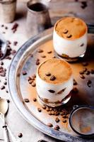 Coffee and rum flavor tiramisu in glass cups