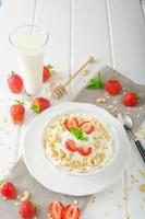 Domestic yogurt with strawberries photo