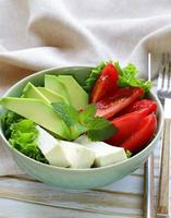salad in asian style with tofu cheese, avocado and tomato photo