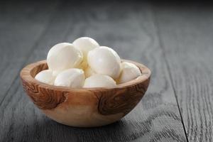 small balls of mozzarella in bowl photo