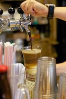Root Beer Float being poured on counter