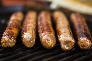 Barbecued beef sausages on grill
