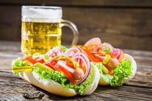 Fresh hot dog with sausage and vegetables