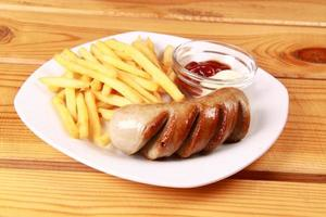 grilled sausages with French fries and ketchup