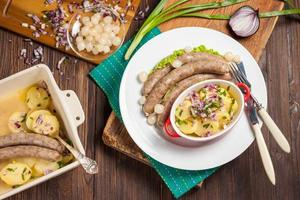Vienna sausages with potato salad and pickled onions