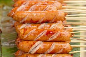 Pork sausages frying photo