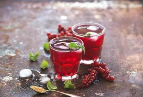 Red berry lemonade with ice and mint on grunge vintage photo