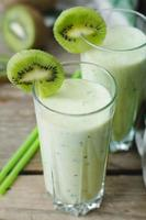 milkshake kiwi in a glass with straws