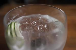 Gin tonic cocktail with cucumber photo